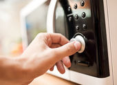 Using microwave oven — Stock Photo