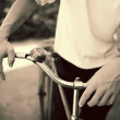 Stock Photo: Mstanding with retro bicycle, close up photo, retro tinted
