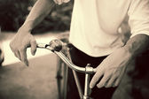 Man standing with retro bicycle, close up photo, retro tinted — Stock Photo