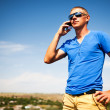 Young man using mobile smart phone, summer outdoor  — Stock Photo