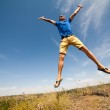 Happy man jumping, blue sky on background, wide angle — Stock Photo #30851203