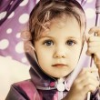 Little cute girl holding an umbrella, close up portrait — Stock Photo #31835777