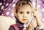Little cute girl holding an umbrella, close up portrait — Stock Photo
