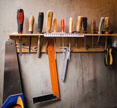 Assortment of tools hanging on the wall — Stock Photo
