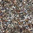 A close up view of different rounded smooth polished pebble ston — Stock Photo