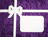 Gift box with blank gift tag — Stock Photo