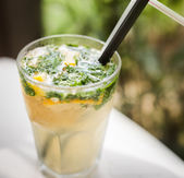 Cocktail Mojito made with mint and lime in summer terreace — Stock Photo