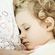 Mother and daughter sleeping on sofa at home, close up photo — Stock Photo