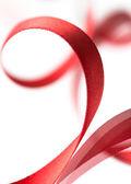 漂亮的面料红丝带白色背景上 — 图库照片
