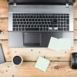 Stockfoto: Workplace, laptop and notepad on wooden table