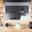 Foto Stock: Workplace, laptop and notepad on wooden table