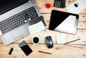 Workplace, laptop and tablet pc on wooden table — Stock Photo