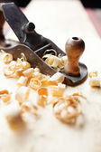 Hand jack plane and wood chips — Stock Photo