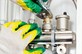 Worker hands fixing heating system — Stok fotoğraf