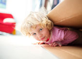 Little girl inside a paper box — Stock Photo