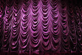 Brightly lit curtains in theatre — Stock Photo