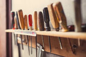 Old woodworking tools on wall, retro tinted — Stock Photo