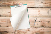 Blank notepad with pen on wood table, free space for text — Stock Photo