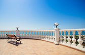 Summer view with classic white balustrade, bench and empty terra — Stock Photo