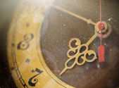 Vintage grunge clock face with vintage roman numerals, tinted ph — Stock Photo