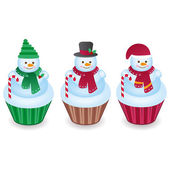 Cute snowman cupcakes isolated on a white background — Stock Vector