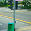 Bin on intersection — Stock Photo