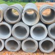 Stacked concrete drainage pipes  — Stockfoto