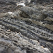 Stratified rocks in a cliff face — Stock Photo