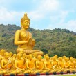 Many buddha statue under blue sky in temple — Stock Photo #43282383