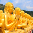Many buddha statue under blue sky in temple — Stock Photo #43282507