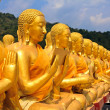 Many buddha statue under blue sky in temple — Stock Photo #43282593