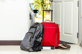 Red travel bag , backpack and shoes — Stock Photo