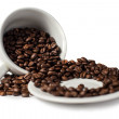 Inverted cup with coffee beans — Stock Photo