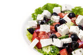 Part of plate with greek salad — Stock Photo