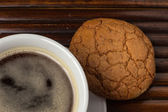 Cup of coffee with almond cookie — Stock Photo
