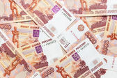 Background from overlapping russian rubles banknotes — Stock Photo