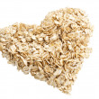 Oat flakes heart angle shot — Stock Photo