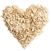 Oat flakes heart shot from above — Stock Photo