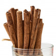Tied sticks of cinnamon in the glass — Stock Photo