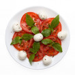 Stock Photo: Caprese salad on plate directly above