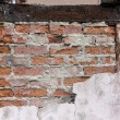 Destroyed plastered brick wall — Stock Photo