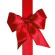 Red ribbon with bow with tails — Stock Photo #14197048