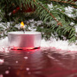 Photo: Christmas background with candle