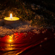 Christmas background with candle — Stok fotoğraf