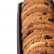 Cookies with chocolate pieces in container — Stock Photo