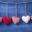 Textile hearts over wooden wall — Stock Photo