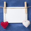 Card and textile hearts over wooden wall — Foto Stock