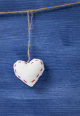 Single textile hearts over wooden wall — Stock Photo