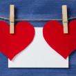 Two paper hearts and card hanging on a rope — Stock Photo