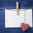 Fabric heart and empty card on wooden background — Stockfoto